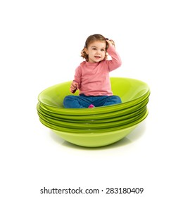 Little girl sitting on bowls