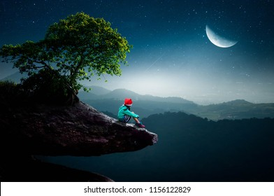 Little girl sitting on a cliff, sitting half moon in the beautiful night.