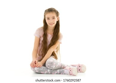 Little girl is sitting on the floor.The concept of a happy child