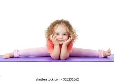 Little girl sitting on the splits