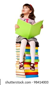 Little girl sitting on stack of books. Isolated over white