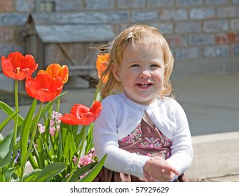 Little Girl Sitting Outside
