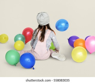 Little Girl Sitting Playing Balloon Portrait