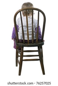 Little Girl Sitting in a Time Out Chair