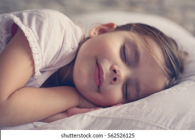 Little girl sleeping in bed.