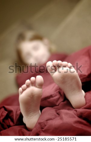 Think, little girl sleeping in bed feet