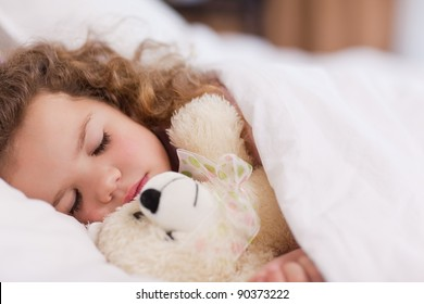 Little girl sleeping with her daddy