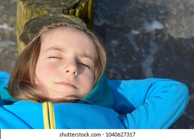little girl sleeping on the beach