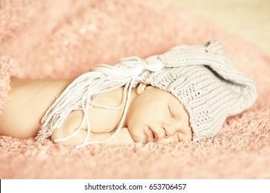 Little girl sleeping on rose background