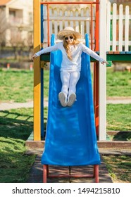 Little girl slide and play at playground.