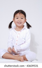 little girl with a smile dressed in white