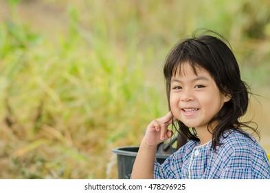 A little girl smile in a field