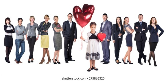 Little girl smile present gift red heart shaped box and balloons in hands. Little girl over big group of Business people on background