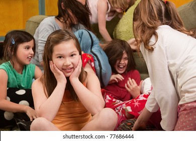 Little girl smiles at a sleepover with friends