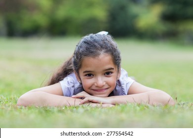 Little girl smiling at the camera on a sunny day