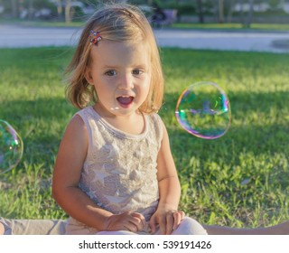little girl smiling with delight