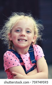 Little girl smiling with first missing tooth