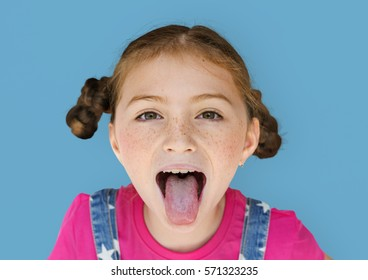 Little Girl Smiling Happiness Sticking Out Tongue Studio Portrait