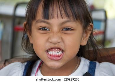 a little girl smiling joyfully