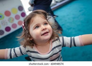 little girl smiling running around the room