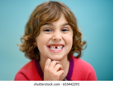 Little Girl Smiling Toothless Smile