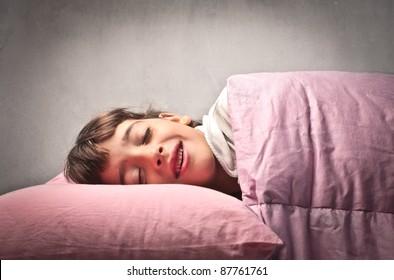 Little girl smiling while sleeping