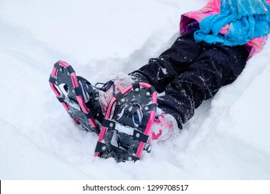Little Girl snowshoeing snow shoeing shoes in winter having fun