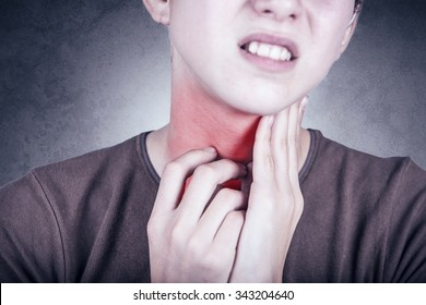 Little girl with sore throat  touching her neck.Sore throat sick.Little girl having pain in her throat.