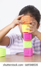 Little girl stacking blocks