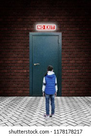 Little girl is standing in front of a closed metal door with glowing words No Exit above it