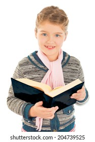 A little girl standing and holding a big book. Smiling and looking at the camera. Isolated on white background.