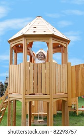 little girl standing in playground tower