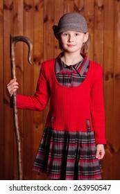 Little girl standing and shepherd holding a shepherd's staff. Farm