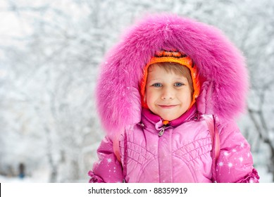 Little girl standing in the snow