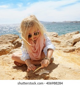 Little girl with starfish. Travel concept