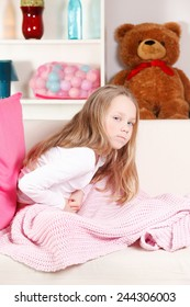 Little girl with stomach-ache