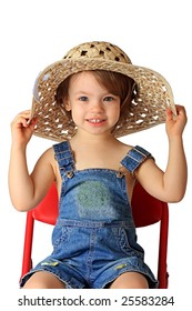 A little girl is in a straw hat.