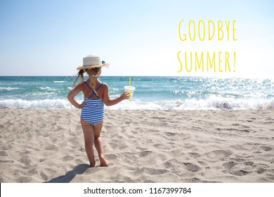 Little girl in a striped swimsuit with hat and cocktail standing back on a background of sea and sand in the summer. Text Summer goodbye.