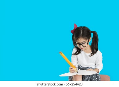 Little girl studio isolated writing on notebook