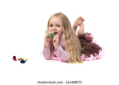 Little girl in studio lying