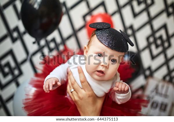 Little girl in studio in mickey mouse hat