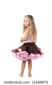 Little girl in studio in skirt