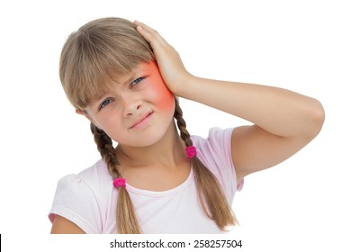 Little girl suffering from earache on white background
