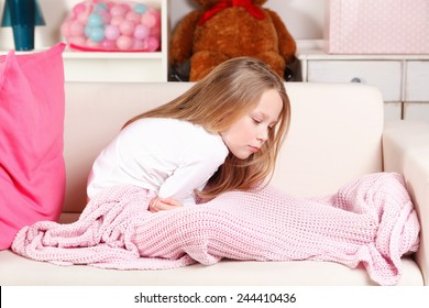 Little girl suffering from stomach-ache