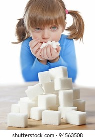 little girl with sugar cubes isolated