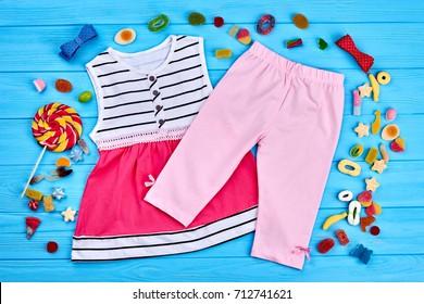 e9cfd3bbd3649 Little girl summer fashion background. Cute leggings and dress for little  girls. Kids summer