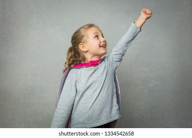 Little girl in superhero costume pretending flight