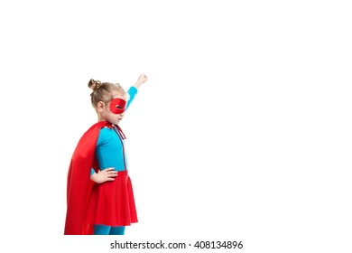 Little girl superhero in a red cloak and mask isolated on white background. Concept of victory and success.