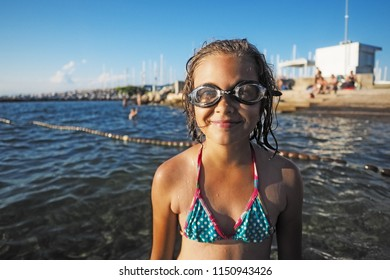 Little girl with swimming glasses