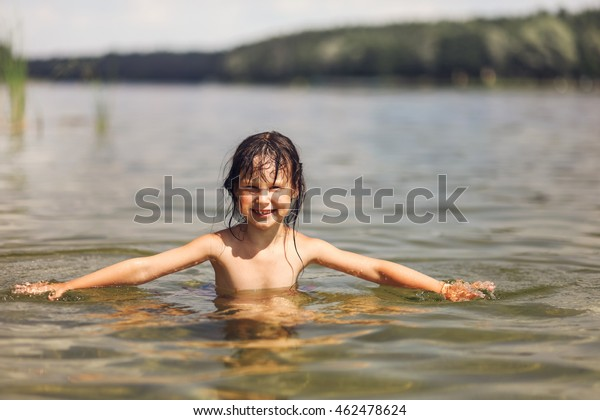 Little Girl Swim In The Lake Stock Photo - Download Image